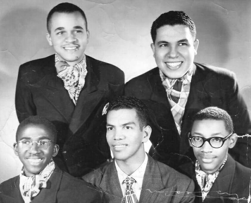 "The Cuban Pipers. Standing, from left to right: Tony Suárez Rocabruna and Regino Tellechea. Seated, from left to right: Hermes Goicochea, Virgilio ""Yiyo"" López and Gilberto Valdés Zequeira. (Photo taken from the blog www.desmemoriados.com)."